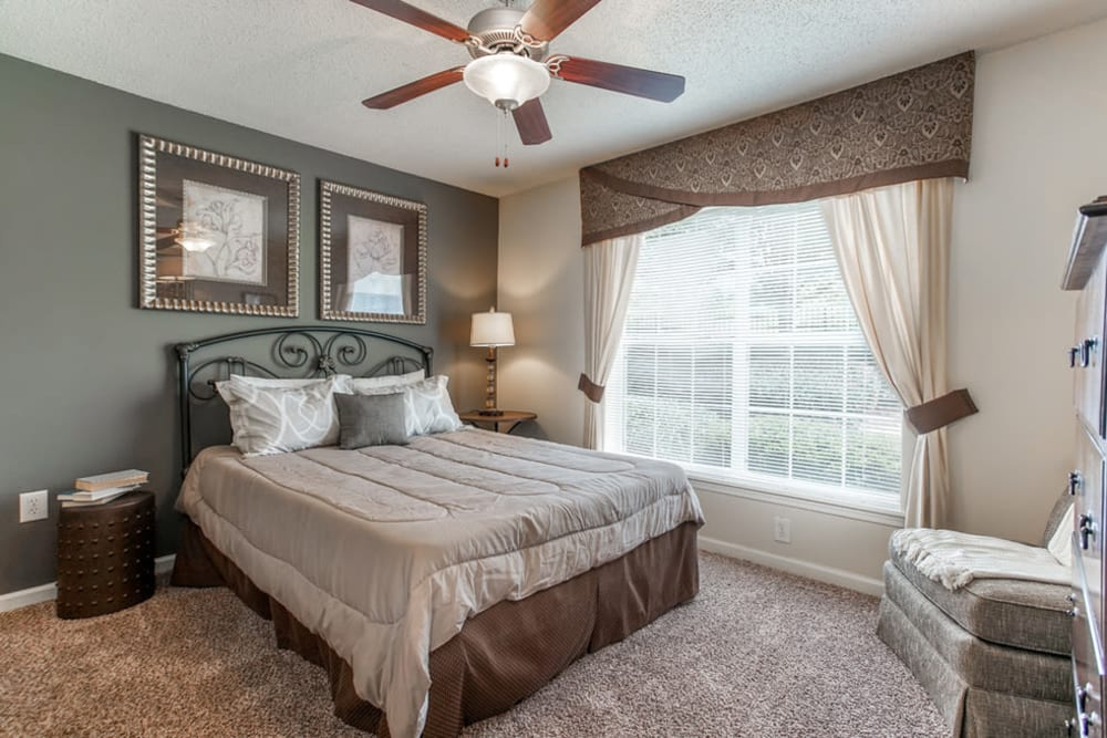 Bedroom with plenty of natural light at Monterey Village in Jonesboro, Georgia