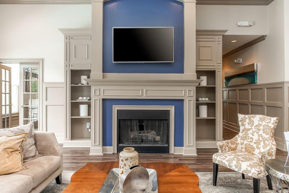 Clubhouse interior with fireplace at Monterey Village in Jonesboro, Georgia