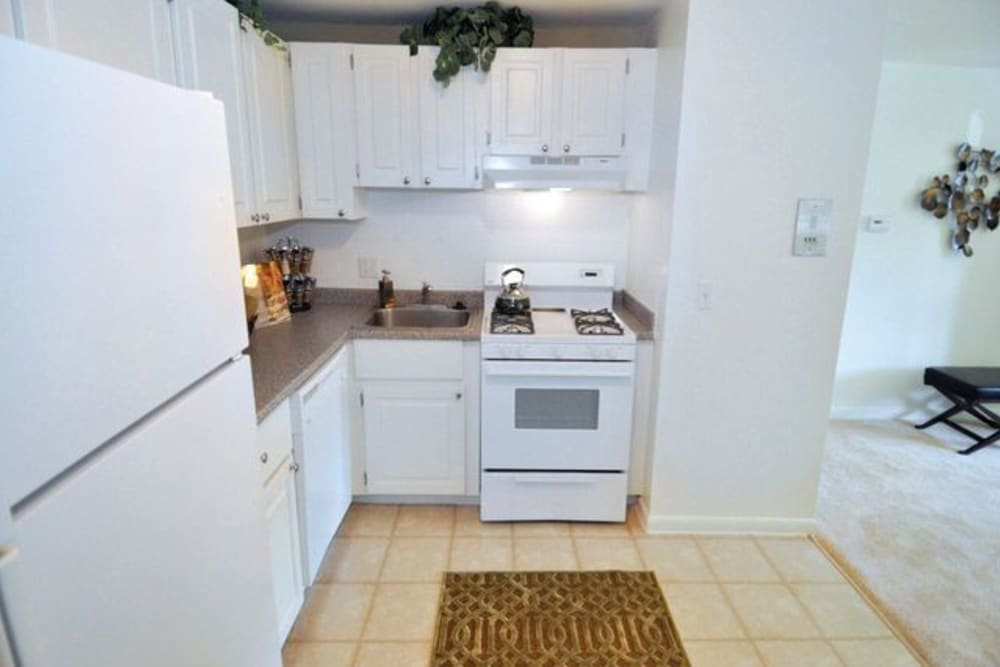 Kitchen with white wood cabinets at Middlesex Crossing in Billerica, Massachusetts
