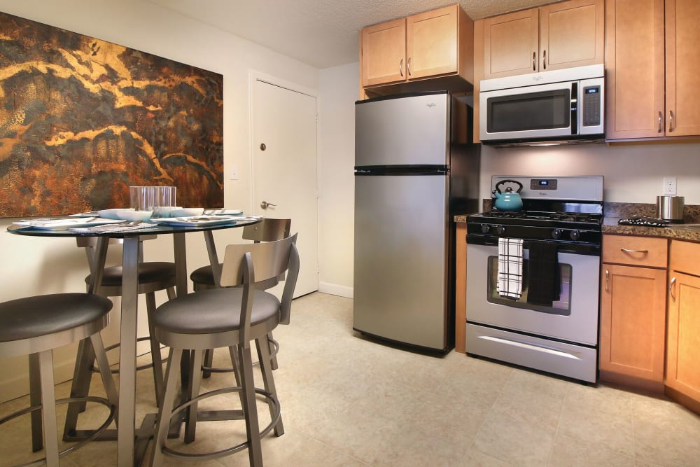 Modern kitchen with dining nook at Middlesex Crossing in Billerica, Massachusetts