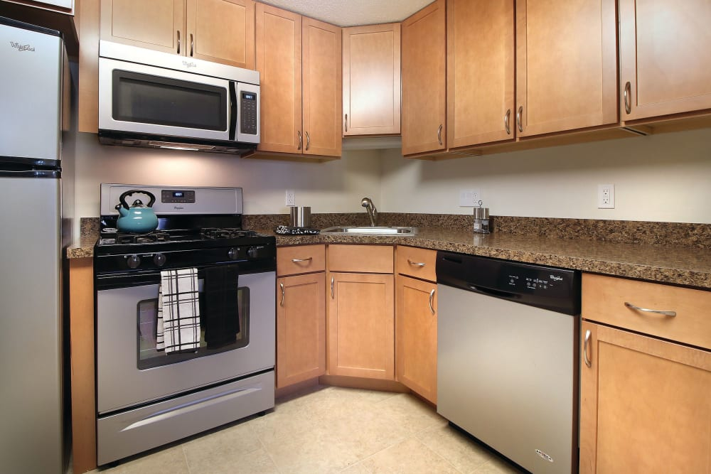 Modern kitchen with stainless steel appliances and granite countertops at Middlesex Crossing in Billerica, Massachusetts
