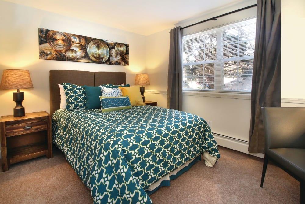 Well lit model bedroom at Middlesex Crossing in Billerica, Massachusetts