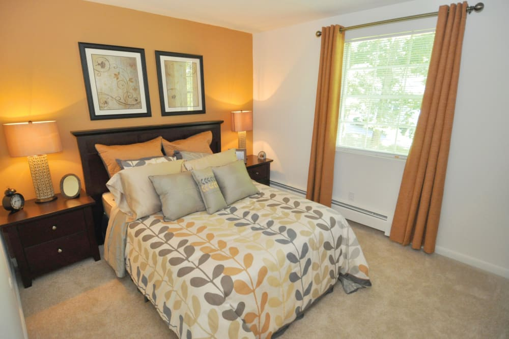 Well decorated model bedroom at Middlesex Crossing in Billerica, Massachusetts