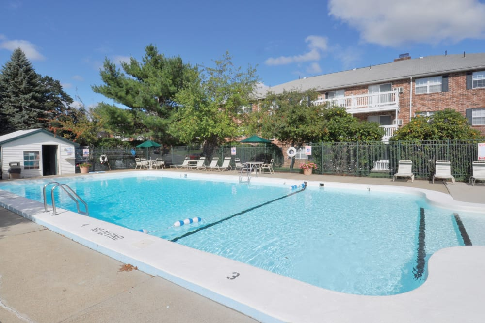 Sunny pool with lounge chairs at Middlesex Crossing in Billerica, Massachusetts