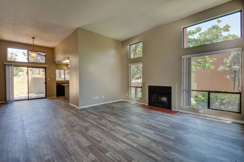 Open concept floor plan with hardwood floors and fireplace at Mesa Del Oso in Albuquerque, New Mexico