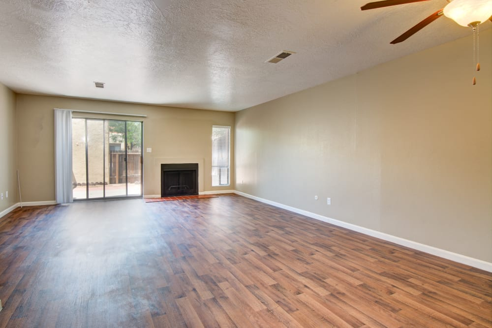 Hardwood floor family room with fireplace at Mesa Del Oso in Albuquerque, New Mexico