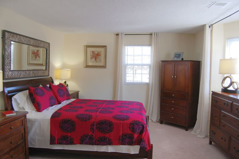 Well decorated model bedroom at Meadows at Marlborough in Marlborough, Massachusetts
