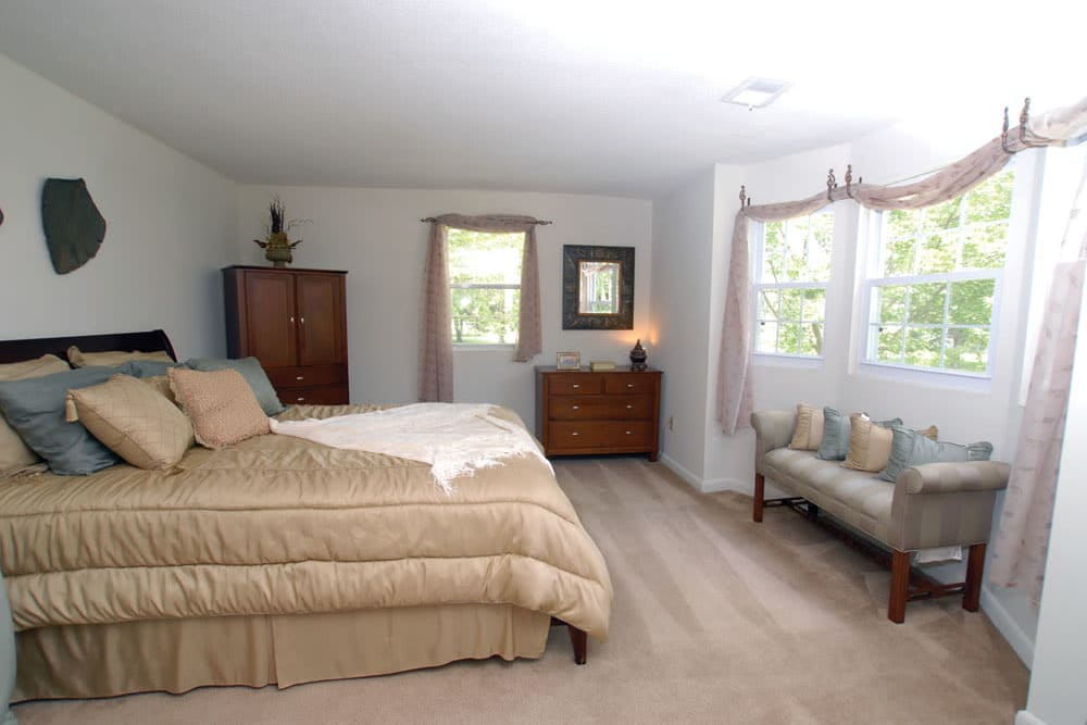 Well lit model bedroom at Meadows at Marlborough in Marlborough, Massachusetts
