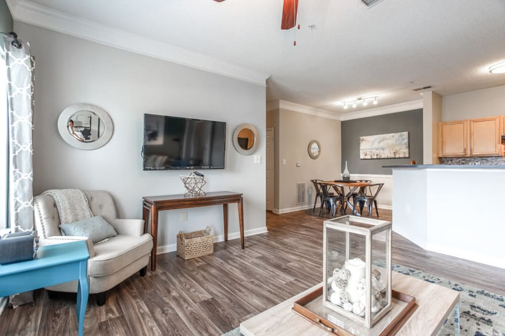 Well lit living room with modern decor and hardwood floors at Meadow View in College Park, Georgia
