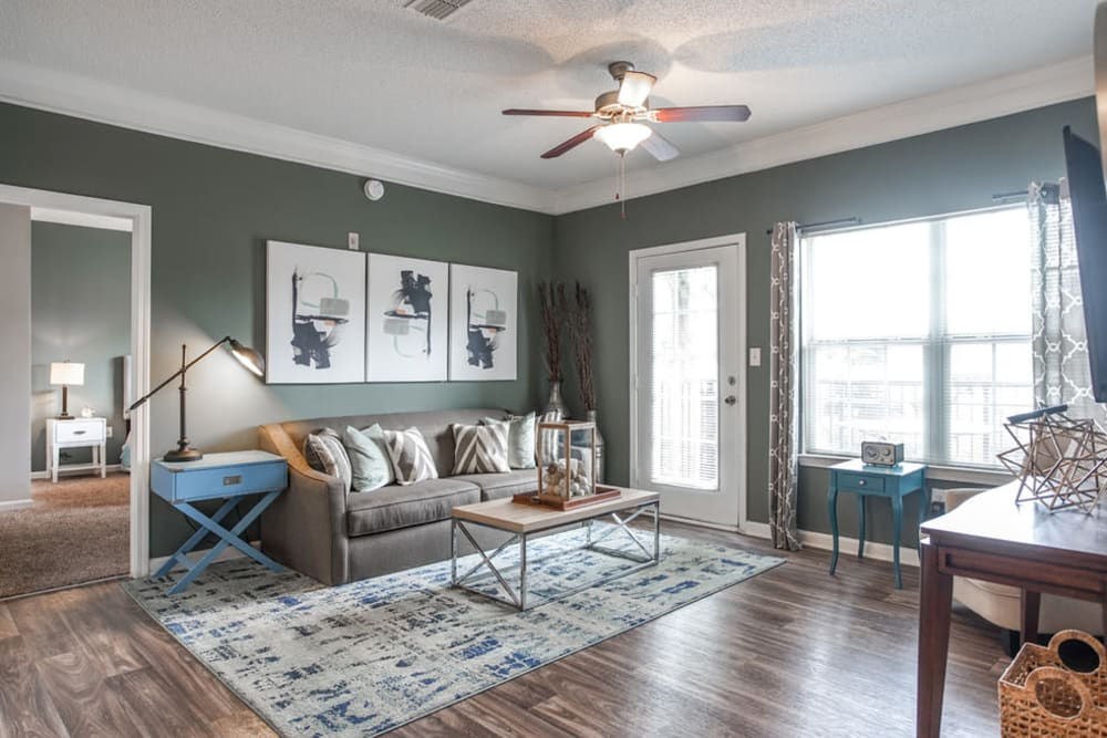Living room with hallway view at Meadow View in College Park, Georgia