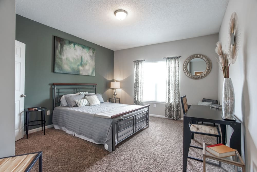 Well decorated model bedroom with great natural light at Meadow View in College Park, Georgia