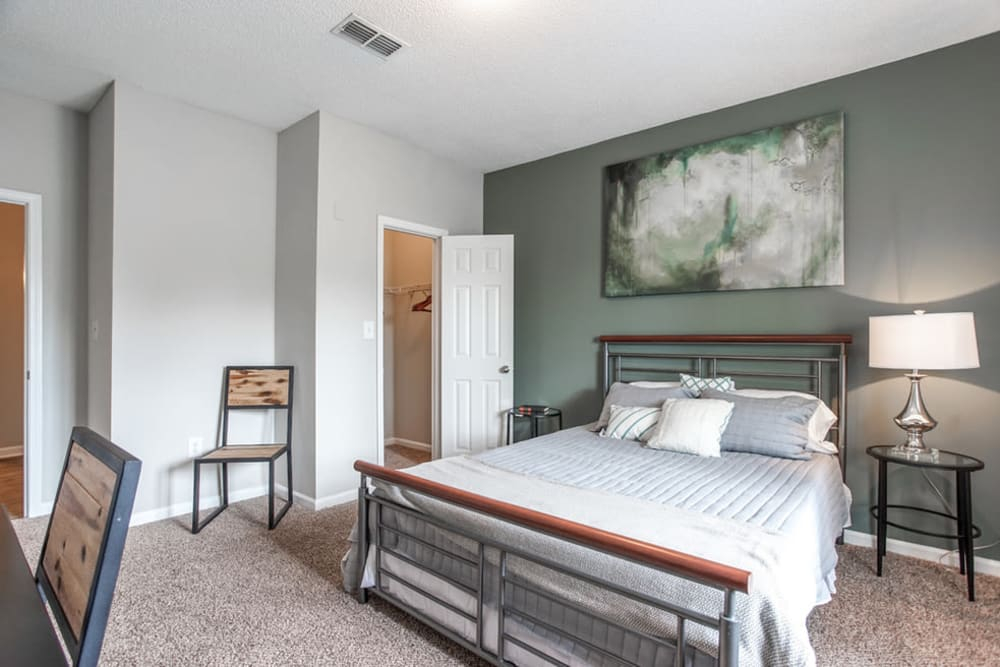 Another view of well decorated model bedroom and closet at Meadow View in College Park, Georgia