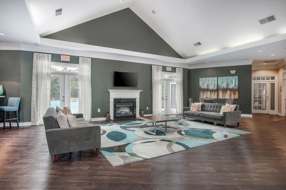Modern decor and hardwood floors in the clubhouse at Meadow View in College Park, Georgia