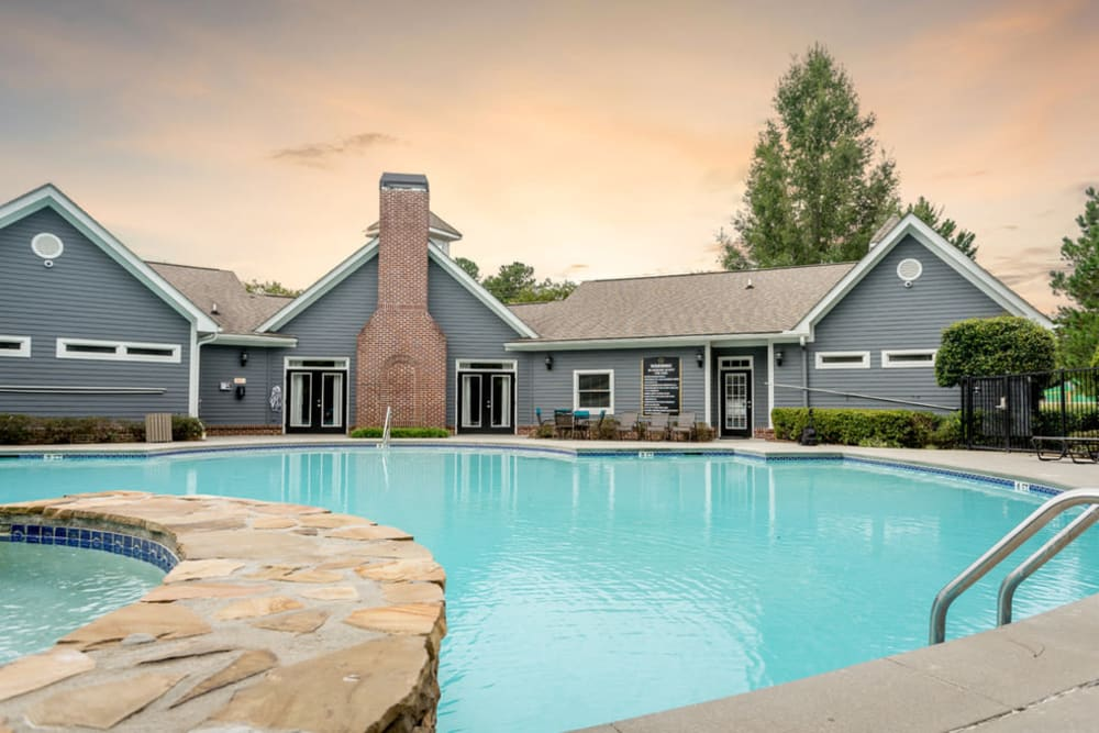 Resort style pool with a sunset backdrop at Meadow View in College Park, Georgia