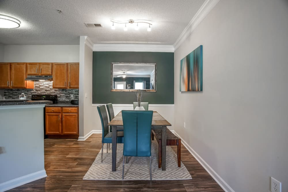 View of dining area and kitchen at Meadow Springs in College Park, Georgia