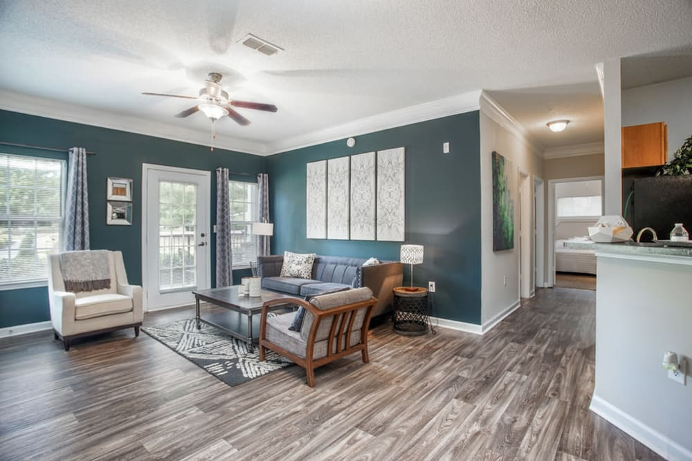 Another view of the open concept layout and hardwood flooring at Meadow Springs in College Park, Georgia