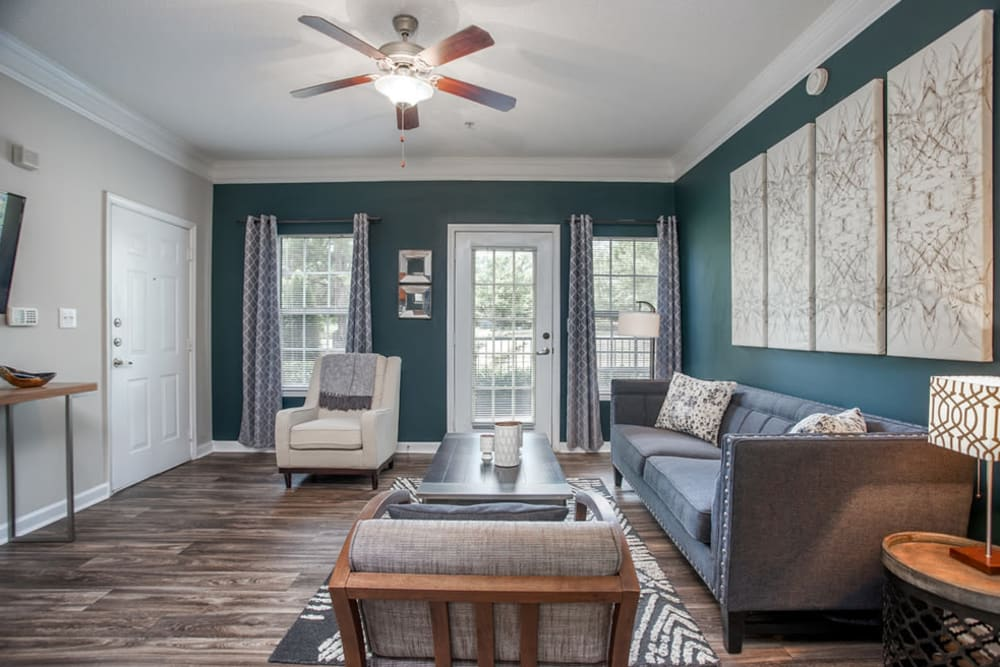Large living room with back patio access at Meadow Springs in College Park, Georgia
