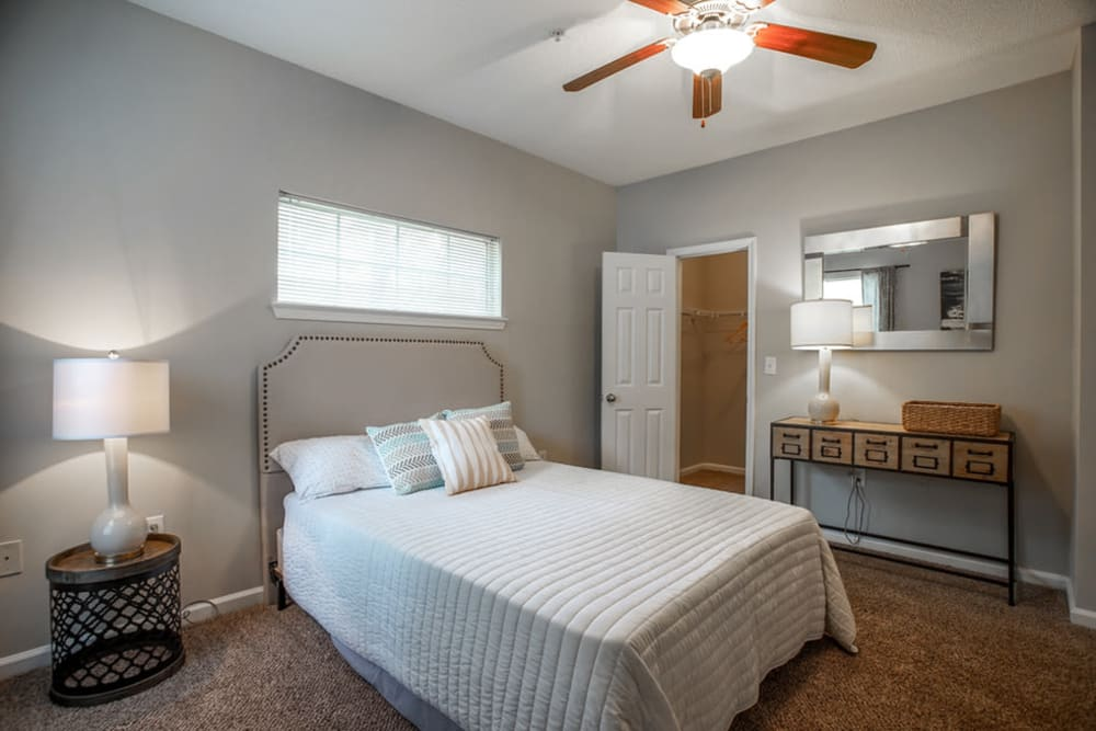 Model bedroom with ceiling fan at Meadow Springs in College Park, Georgia