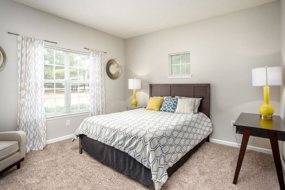 Well lit model bedroom at Meadow Springs in College Park, Georgia