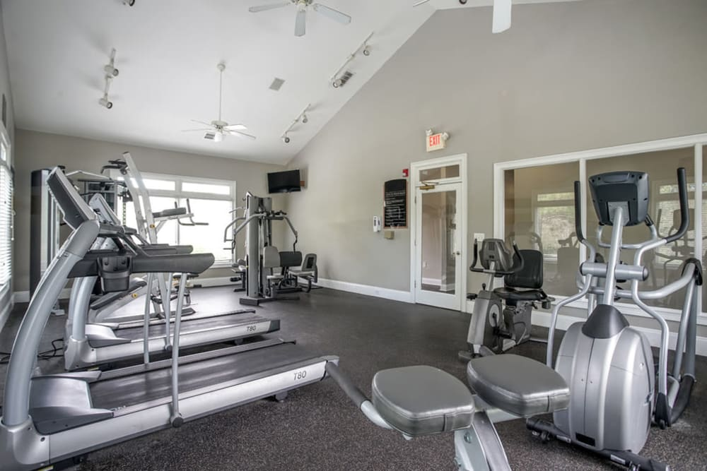 Well equipped fitness center with treadmills at Meadow Springs in College Park, Georgia