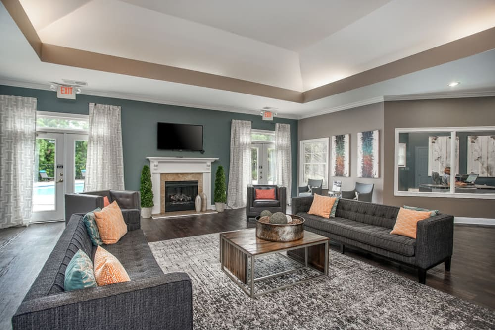 Clubhouse interior with fireplace and modern Decor at Meadow Springs in College Park, Georgia