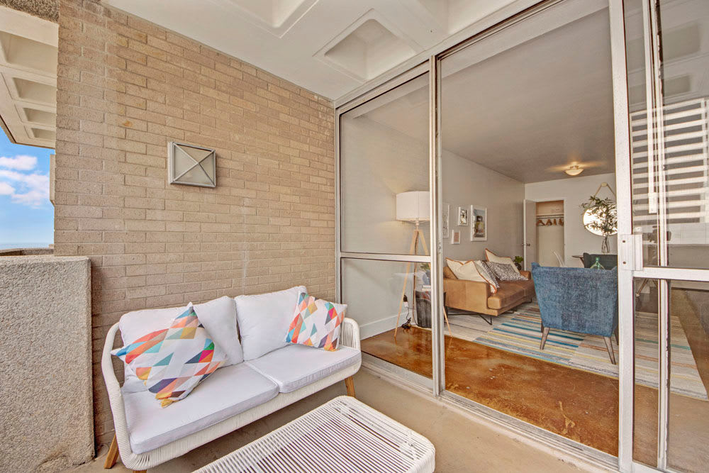 A look inside the apartment unit from the patio at Manor House in Dallas, Texas