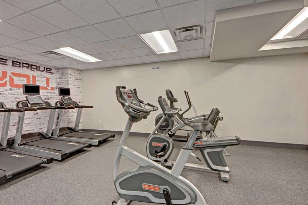 Treadmills and ellipticals in the fitness center at Manor House in Dallas, Texas