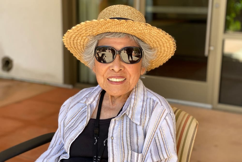 Resident in a sun hat and glasses at Clearwater at South Bay