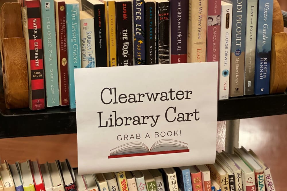 Library cart full of books at Clearwater at South Bay