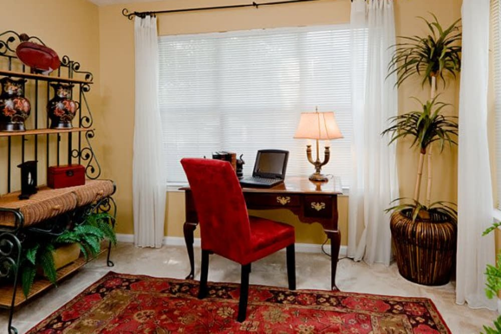 Desk and chair in front of large window in an apartment at Holland Park in Lawrenceville, Georgia