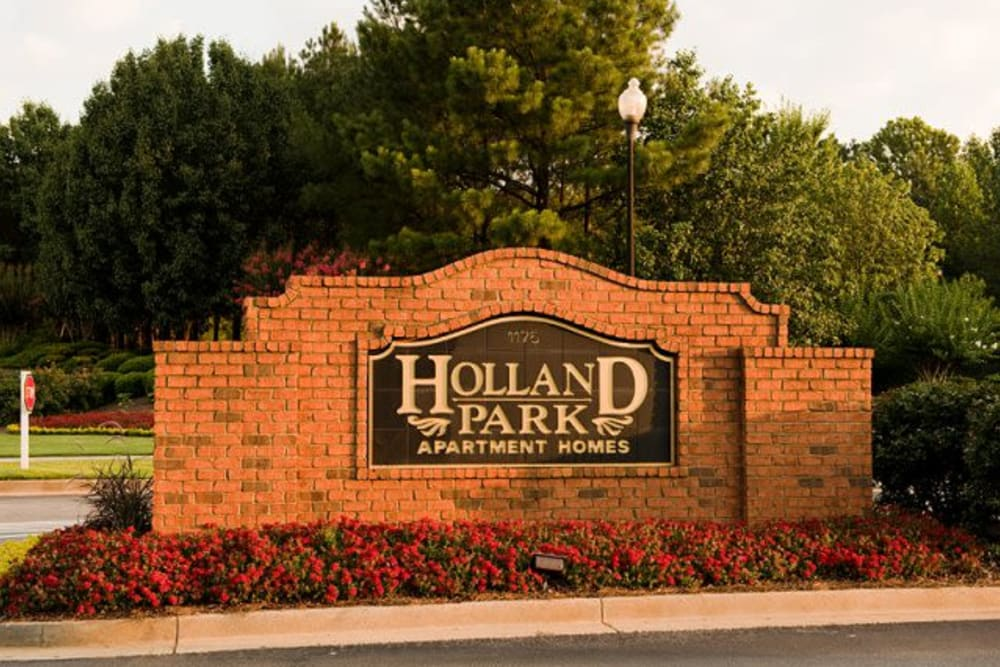 Community sign at entrance to Holland Park