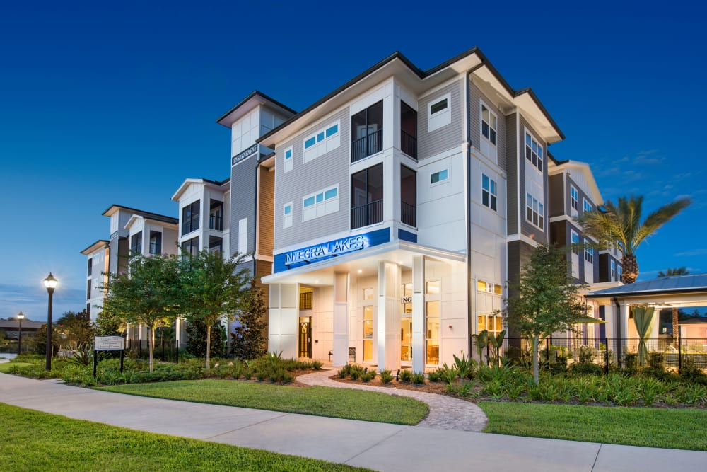 Apartment building lit up at night at Integra Lakes in Casselberry, Florida
