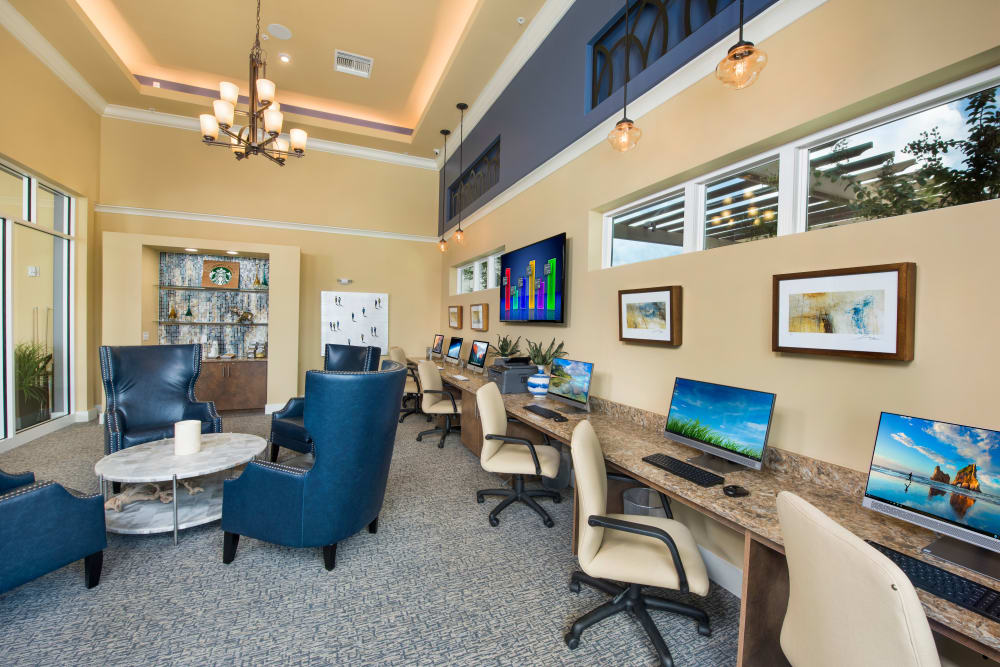 Clubhouse interior at Integra Lakes in Casselberry, Florida features a business center