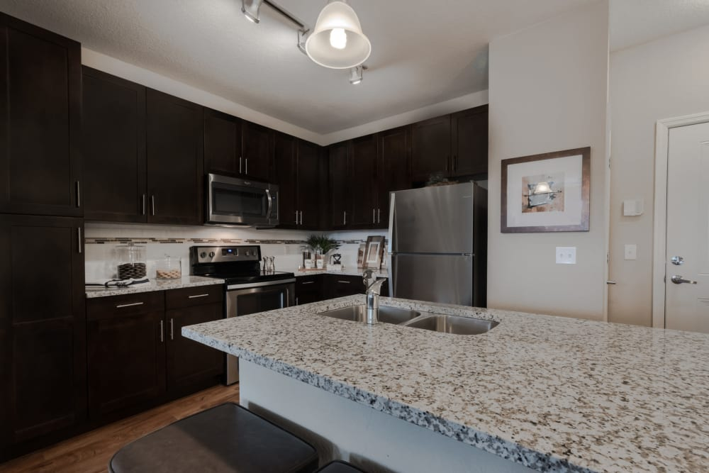 Kitchen featuring island and stainless steel appliances at Integra Lakes in Casselberry, Florida