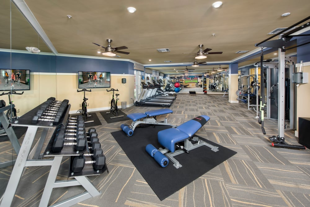 Fitness center at our apartments in Casselberry, Florida feature free weights and other modern workout equipment