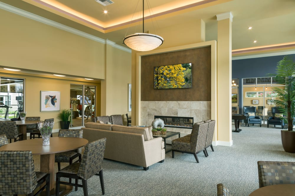 Community clubhouse at Integra Lakes features fireplace sitting area