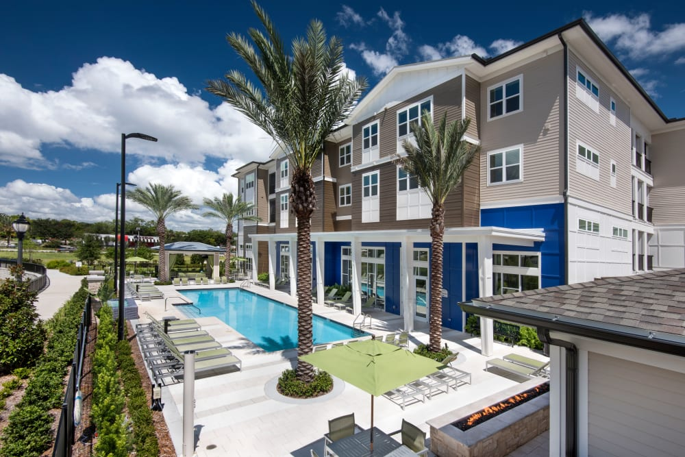 Building exterior and community pool at Integra Lakes in Casselberry, Florida