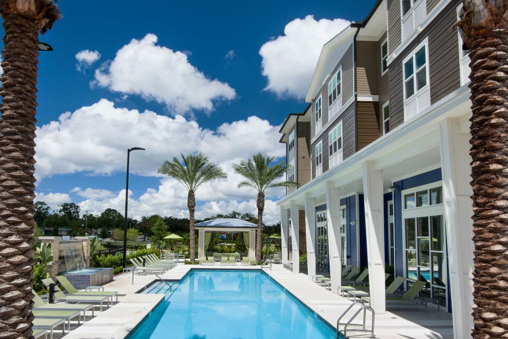 Blue sky and clouds over community pool at Apartments in Casselberry, Florida