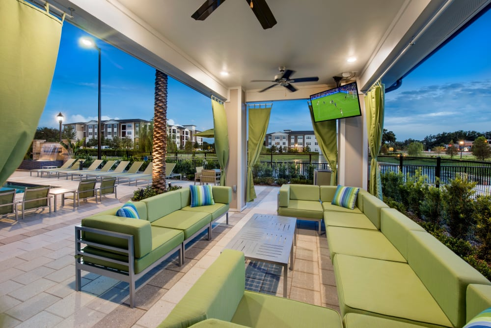 Outdoor sitting area TV and ceiling fan at Integra Lakes in Casselberry, Florida