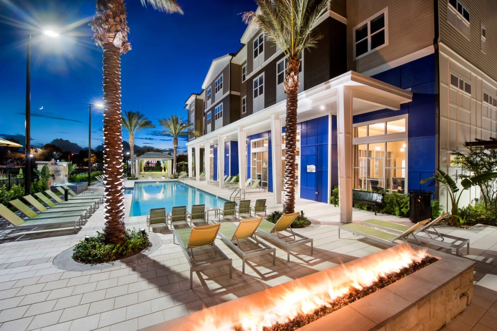 Fire pit by community pool at Integra Lakes in Casselberry, Florida