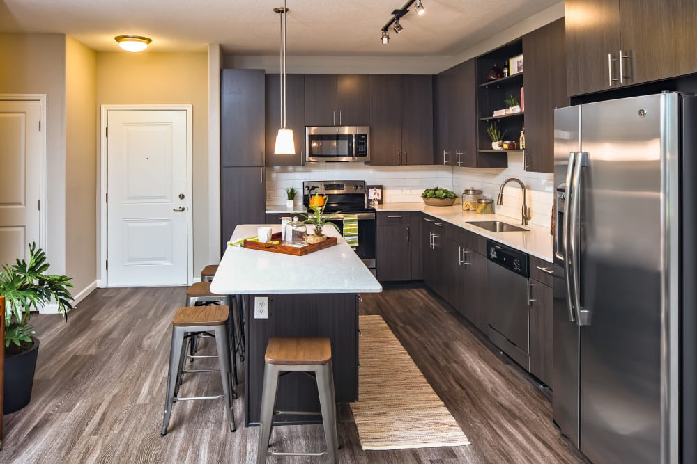 Stainless steel appliances and hardwood floors are features of this kitchen at Linden Audubon Park in Orlando, Florida