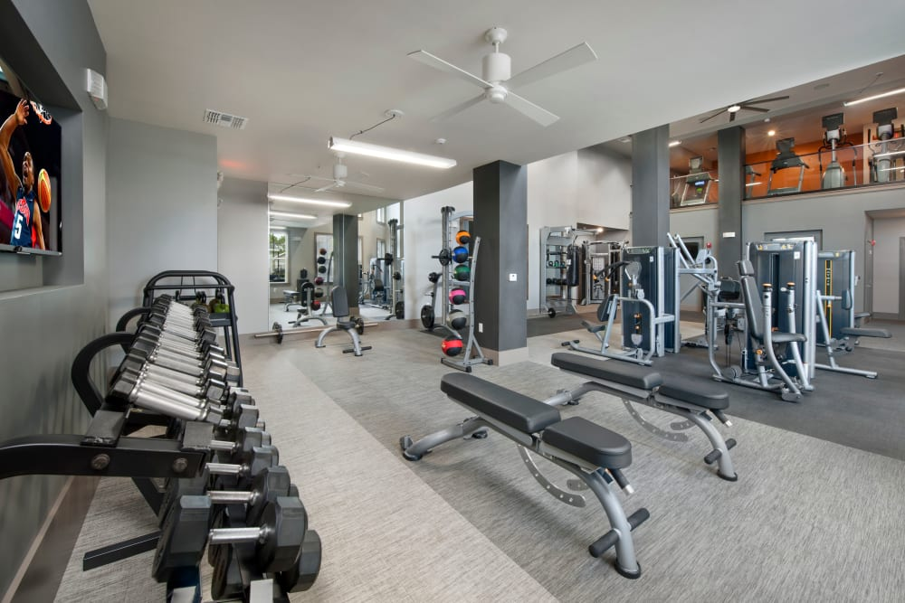 Free weights and other fitness equipment at Linden Crossroads in Orlando, Florida