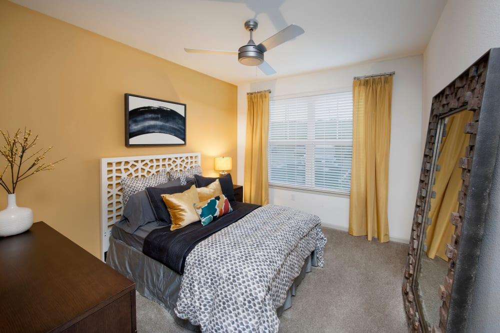 Bright yellow bedroom at Linden Crossroads in Orlando, Florida
