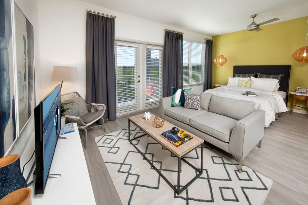Bedroom at Linden Crossroads in Orlando, Florida features large windows and french doors leading to outside