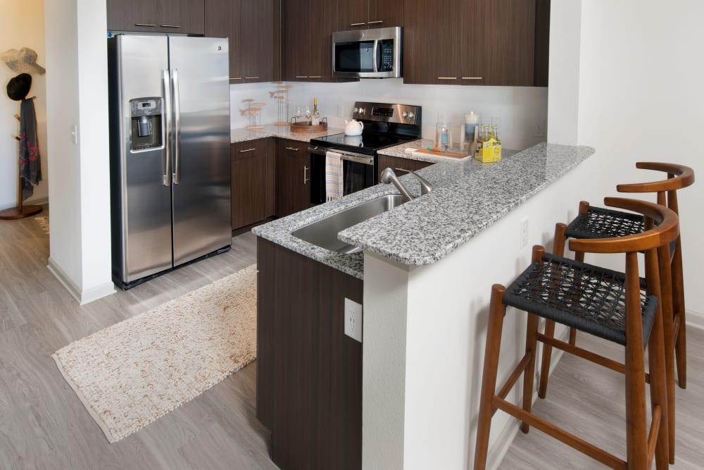 Our Unique Apartments in Orlando, Florida showcase a Kitchen featuring breakfast bar seating