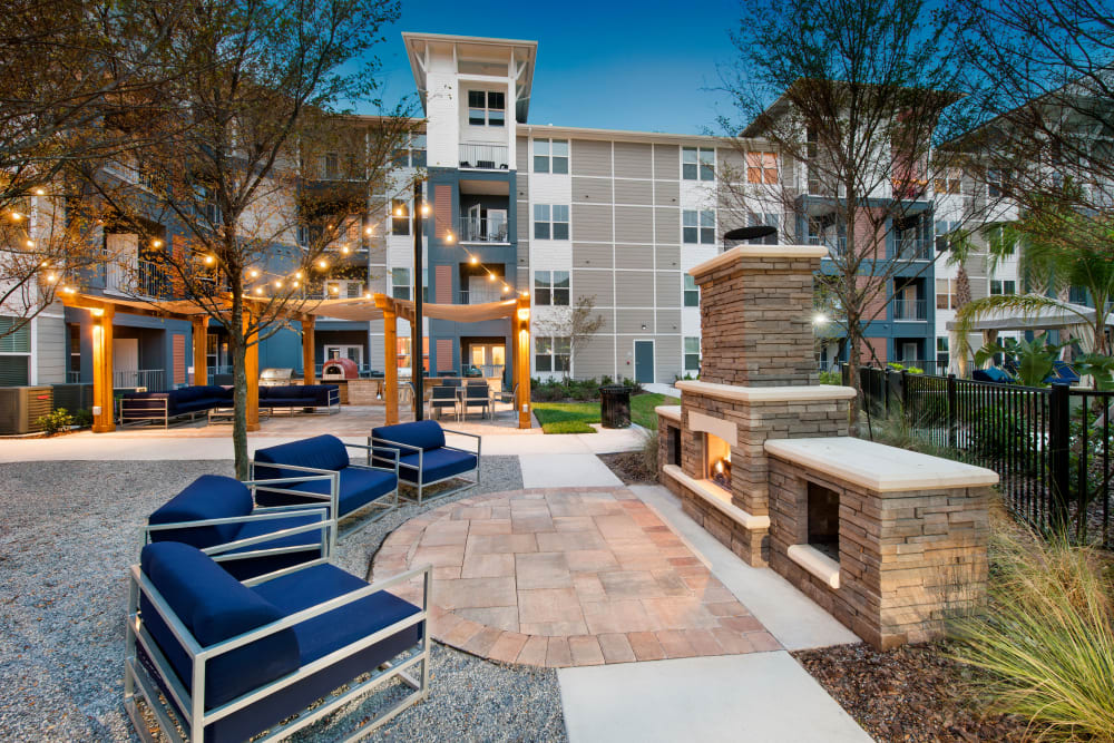 Outdoor patio seating by a fire pit at Linden Crossroads in Orlando, Florida