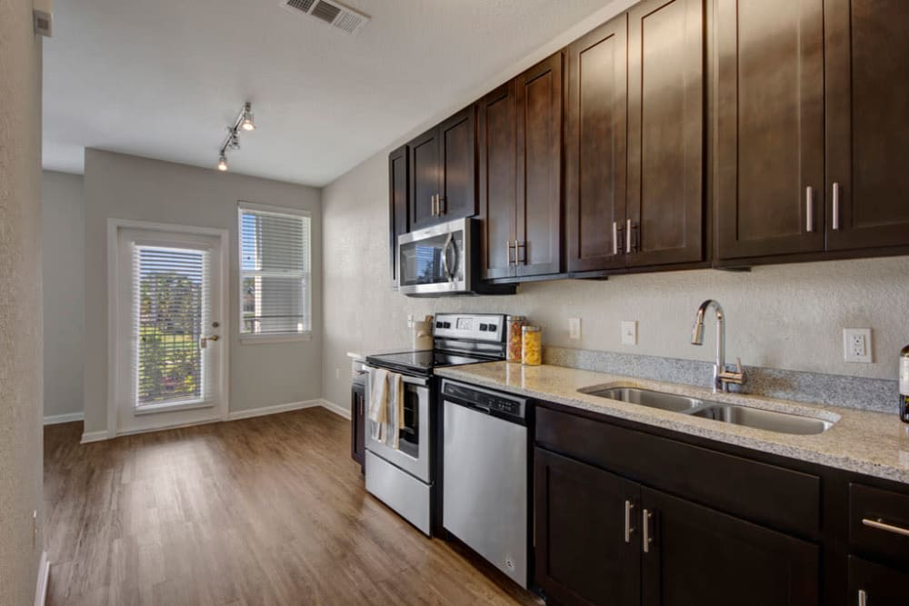Kitchen featuring stainless steel appliances at Linden on the GreeneWay in Orlando, Florida