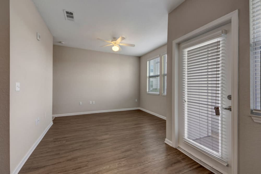 Spacious room with the door to outside at Linden on the GreeneWay in Orlando, Florida