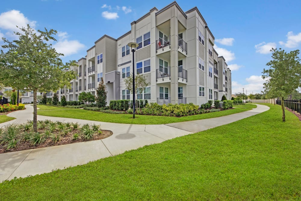 Apartment building with well manicured grounds at Linden on the GreeneWay in Orlando, Florida
