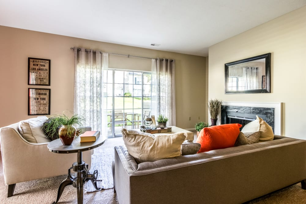Well decorated living room with plenty of natural light at Sycamore Ridge in Dublin, Ohio